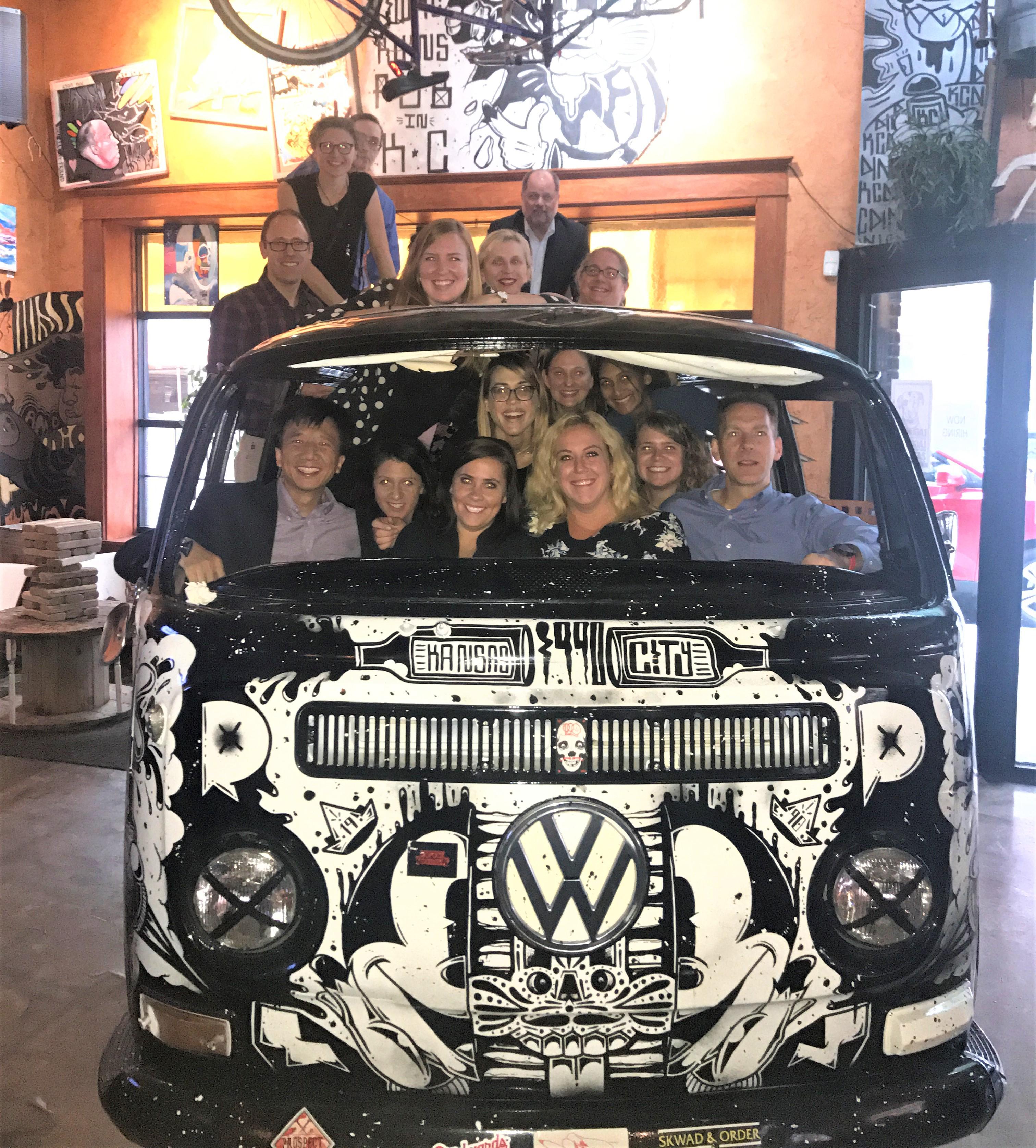 Group Photo of Department Members in VW Bus